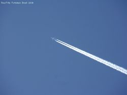 A high-flying jet's engines leaving a condensation trail