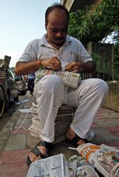 45 Every morning at 6am the Delhi newspapermen assemble bundles of papers for delivery