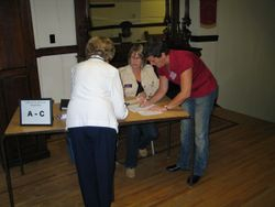 Cathy and Kim working one of the registration tables.