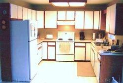BEFORE - Raised Panel White Laquer Kitchen