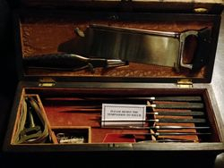 Civil War field surgery kit with bone saw.