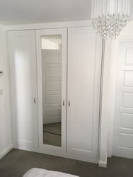 Fitted wardrobes in bedroom.