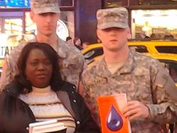 U.S Army soilders with a copy of This Can't Be Love.