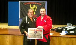 Presentation of Master Title and 3rd Dan Self Defence to Alan Mitchell by Hanshi Claudio Artusi - Thurso June 2012