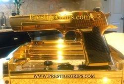 24 Karat Gold & Titanium DESERT EAGLE .50 with Black CF grips mounted