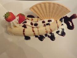 ice cream Banana splt waffer dessert with fruit and chocolate sauce.