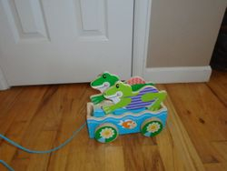 Melissa & Doug First Play Friendly Frogs Wooden Pull Toy - $10