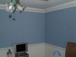 Wallpaper above a chair rail.