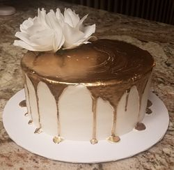 Gold Drip Cake with white flower