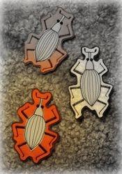 Heijastavat koppakuoriaiset, Reflective beetle