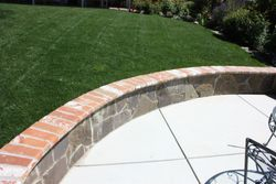 Seat wall with brick cap and flagstone facing
