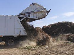 Large Trucks Carrying Debris
