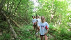 Cheerleaders heading up the trail that leads to the Flight 371 crash site