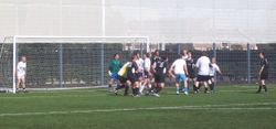 A PACKED GOALMOUTH