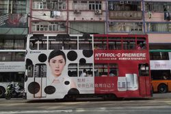 Car #125 advertising facial care products on Hennessy Road.
