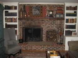 New bookcases each side of fireplace