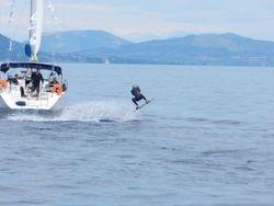 Wakeboarding behind sailing yachts Zephyros