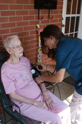 Andrea, CNA with patient