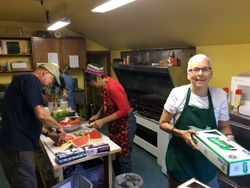 Gay (green apron) Runs the Kitchen
