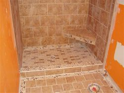 walk in shower with tiled bench