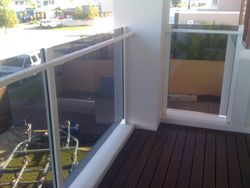 Glass balustrade with a grab rail