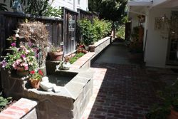 Water feature with wing walls finished with a bullnose brick cap and flagstone facing