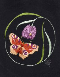 Peacock butterfly with fritillary lily