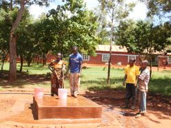The pipeline to the Primary School ends at a faucet so water is available to both the school and to nearby Pommern residents.