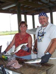 Barbara & Tom Cleaning Fish