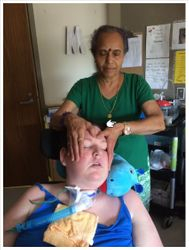 Relaxed client while receiving treatment at the care centre