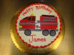 8 inch round cake with flat fire truck $75