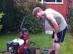 My son, Richard using the turf cutter