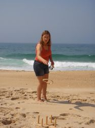 Playing quoits on the beach near the marina in Nazares