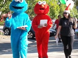 Elmo and other characters in the street