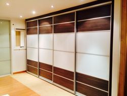 Wenge and pure white wardrobe doors.