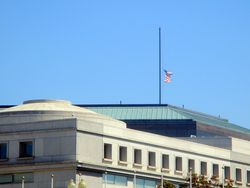 South Flagpole of Thurgood Marshall Federal Judiciary Building at Half Staff in Honor of Lying in Repose of Associate Supreme Court Justice Ruth Bader Ginsburg from Southwest