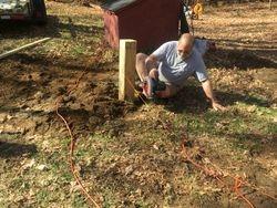 Verne N5IEP plumbing a post