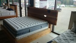 kingsize bed made from cedar sourced from burned forest