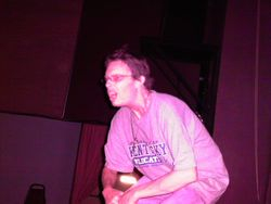 Brandon performing onstage.