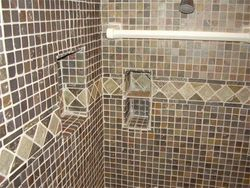 Tiled shower walls with built in shelves