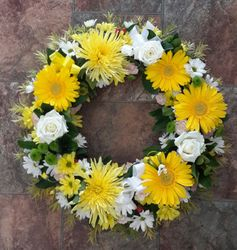 Yellow and white funeral wreath