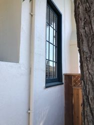 Repaired stucco by window