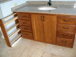 Bathroom vanity, drawer pull out shown