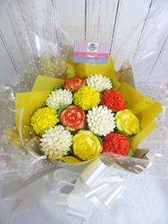 Yellow, orange and white cupcake bouquet