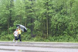 Support Kat at leg 8 in the pouring rain!