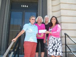 Hope Flores presents a check to LCCCPS members.