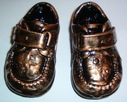 Pair of unmounted shoes - Bronze