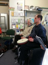 """Alan playing the tambourine with """"Whittlesea Town"""""""