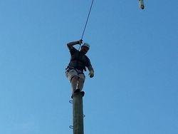 Matt climbs to top of pole 2