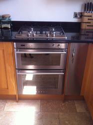 'Stoves' gas hob set into purpose designed black granite worktop.
